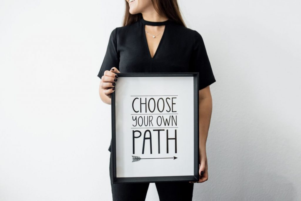 choose your own path sign in girls hands