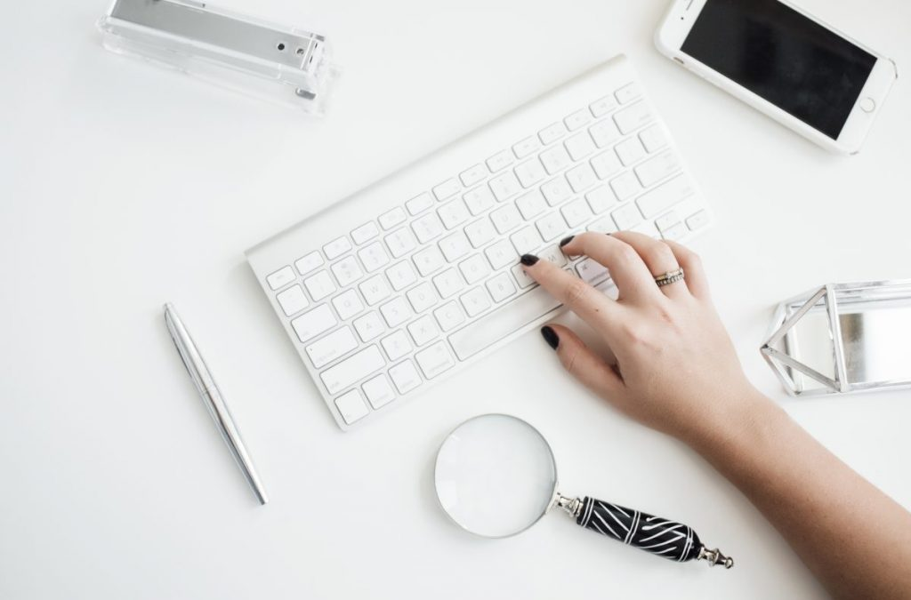 keyboard and hand | How long should blog posts be for SEO?